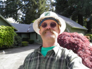 David. D. Hunter, certified arborist, working in a neighborhood